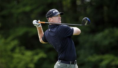 Hunter Mahan watches his tee shot on the 14th hole during the second round of the Travelers Championship golf tournament, Friday, June 26, 2015, in Cromwell, Conn. (AP Photo/Stew Milne)