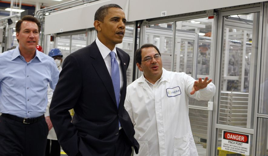 President Obama is given a tour of Solyndra by Executive Vice President Ben Bierman (right) as Chief Executive Officer Chris Gronet walks along at Solyndra Inc. in Fremont, Calif., on May 26, 2010. (Associated Press)