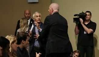A security guard for Republican presidential candidate Donald Trump removes Miami-based Univision anchor Jorge Ramos from a news conference, Tuesday, Aug. 25, 2015, in Dubuque, Iowa. Ramos stood up and began to ask Trump about his immigration proposal. (AP Photo/Charlie Neibergall)