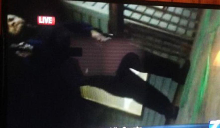In this framegrab from video made by the camera of WDBJ-TV cameraman Adam Ward, Vester Lee Flanagan II stands over Mr. Ward with a gun after fatally shooting him and reporter Alison Parker on Wednesday during a live on-air interview in Moneta, Va. (Twitter via Associated Press)
