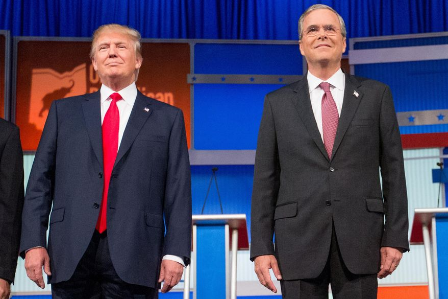 In this photo taken Aug. 6, 2015, Republican presidential candidates Donald Trump and former Florida Gov. Jeb Bush, take the stage for the first Republican presidential debate at the Quicken Loans Arena in Cleveland. Donald Trump is used to controlling his world like the boss he is. But as president, he'd answer to the people. And so far in the rollicking 2016 presidential contest, he's showing little willingness to dial down his because-I-said-so style. (AP Photo/Andrew Harnik)