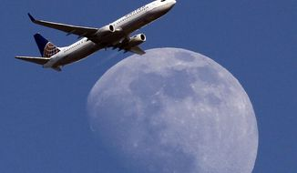 In this July 26, 2015, file photo, a United Airlines passenger airplane passes over Whittier, Calif., on its way to Los Angeles International Airport. Fliers in certain markets are seeing bargain flights as fare wars make a limited return. (AP Photo/Nick Ut, File)