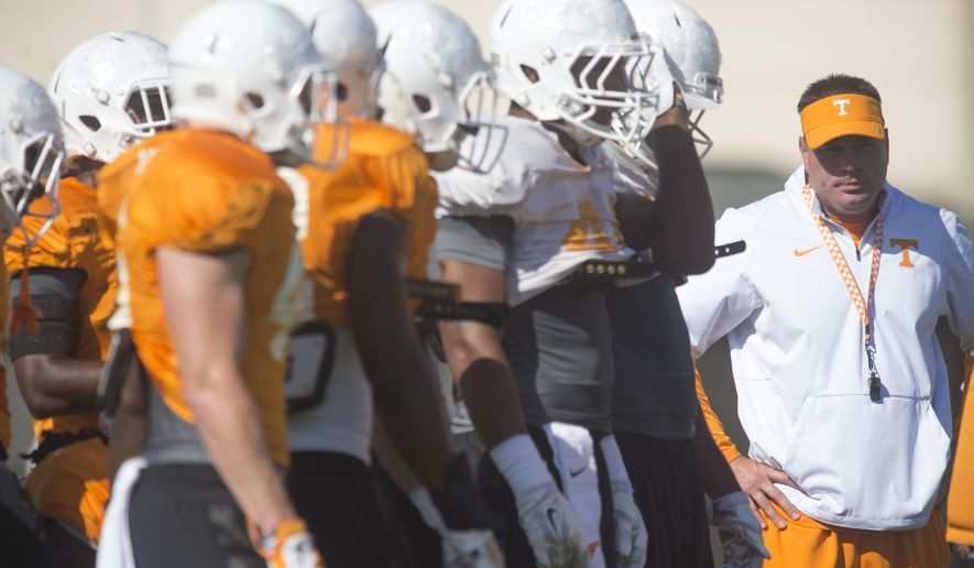 Tennessee head coach Butch Jones, right, works with special teams during NCAA college football practice in Knoxville, Tenn., Wednesday, Aug. 26, 2015. (Saul Young/Knoxville News Sentinel via AP) MANDATORY CREDIT