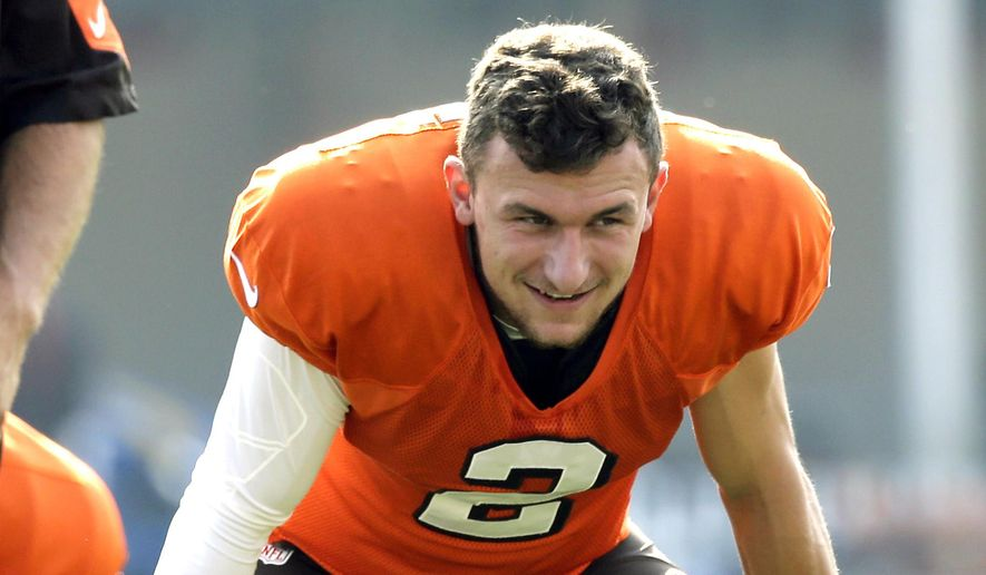 """In this Aug. 10, 2015 photo, Cleveland Browns quarterback Johnny Manziel smiles as he stretches during practice at the NFL football team's training camp Monday in Berea, Ohio. More college football stars are starting to snatch up trademark rights to their names, nicknames and fan slogans. Manziel famously won the rights to """"Johnny Football"""" in 2013 only after filing a lawsuit against a T-shirt maker that had also claimed ownership of his nickname. (AP Photo/Tony Dejak)"""