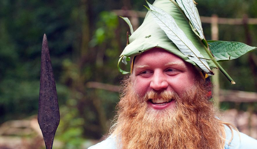 A 2014 photo provided by Justin Wren shows mixed martial arts fighter Justin Wren in the homeland of the Mbuti pygmy tribe in the Ituri Rainforest in the Democratic Republic of Congo. Wren will end a five-year absence from mixed martial arts when he fights for the Bellator promotion Friday, Aug. 28, 2015, in Temecula, Calif. The heavyweight left his sport to devote himself to helping the Congo's Mbuti pygmy tribes with clean drinking water and agriculture. (Agung Fauzi/Justin Wren via AP)