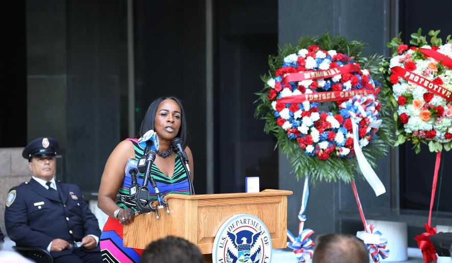 Idrissa Camara's colleague Carolyn Harley, who worked with Camara at a federal office building, speaks at a memorial service for the slain guard on Thursday, Aug. 27, 2015, in New York, outside the building where the shooting took place. Camara was killed on Aug. 21 when a gunman shot the senior guard at close range before killing himself. (AP Photo/Mike Balsamo)