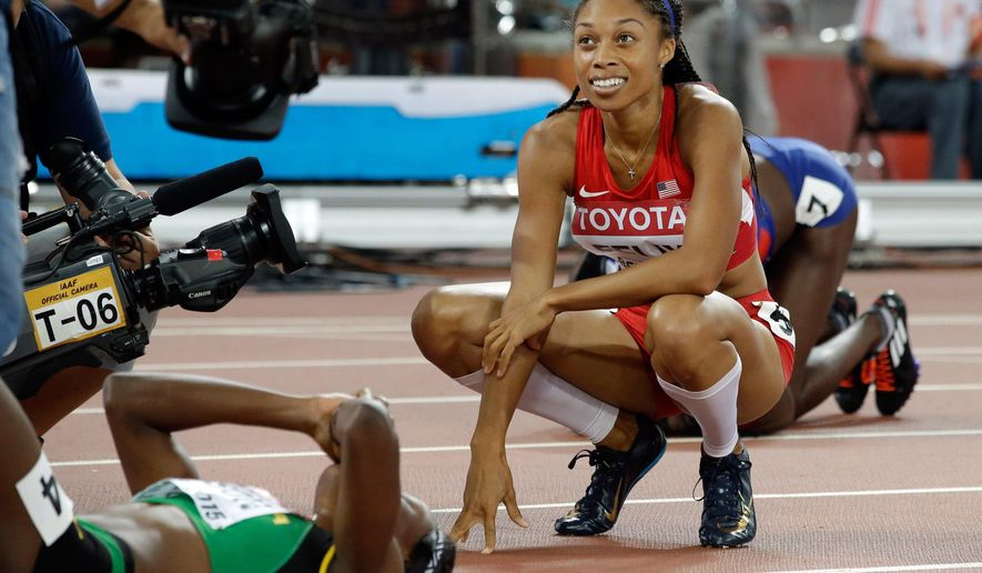 United States' Allyson Felix smiles after she wons the gold medal in the women's 400m final at the World Athletics Championships at the Bird's Nest stadium in Beijing, Thursday, Aug. 27, 2015.  (AP Photo/Lee Jin-man)