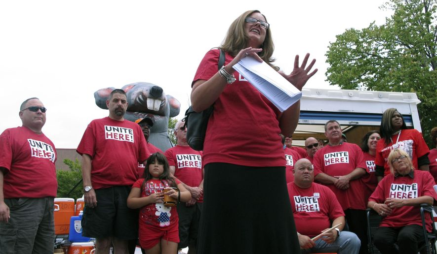 In this Aug. 25, 2015 photo, Valerie McMorris, a cocktail server at the Trump Taj Mahal casino, speaks at a union rally in Atlantic City, N.J. as Local 54 of the Unite-HERE union gathered supplies for a threatened strike against the Taj Mahal. On Thursday Aug. 27, 2015, the New Jersey AFL-CIO urged union members to boycott the Taj Mahal and The Tropicana, both owned or about to be owned by billionaire Carl Icahn, due to a protracted labor dispute with the union. (AP Photo/Wayne Parry)