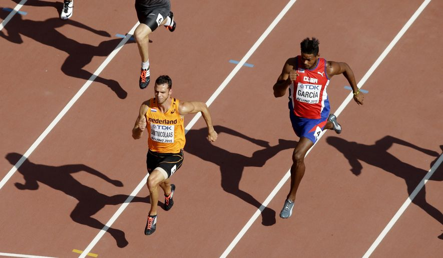 Eelco Sintnicolaas of the Netherlands races clear of Cuba's Yordani Garcia in a men's 100m decathlon heat at the World Athletic Championships at the Bird's Nest stadium in Beijing, Friday, Aug. 28, 2015. (AP Photo/Wong Maye-E)