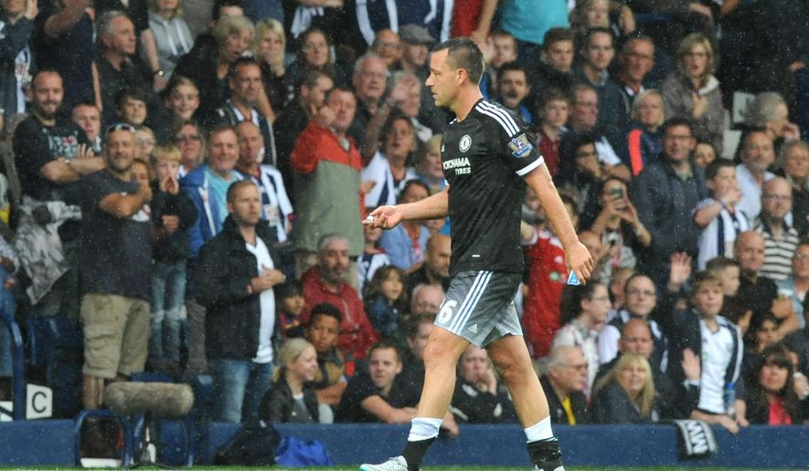 Chelsea's John Terry leaves the pitch after being sent off during the English Premier League soccer match between West Bromwich Albion and Chelsea at the Hawthorns, West Bromwich, England, Sunday, Aug. 23, 2015. (AP Photo/Rui Vieira)