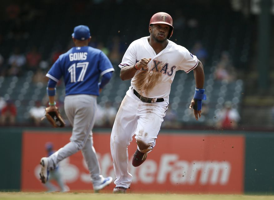 Texas Rangers' Delino DeShields advances to third on a single by Texas Rangers' Adrian Beltre in the first inning of a baseball game Thursday, Aug. 27, 2015, in Arlington, Texas. (AP Photo/Tony Gutierrez)