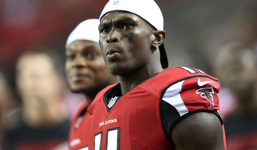 FILE - In this Aug. 14, 2015, file photo, Atlanta Falcons wide receiver Julio Jones (11) watches from the sidelines during the second half of an NFL football preseason game against the Tennessee Titans in Atlanta. As his agent negotiates a new contract with the Falcons, two-time Pro Bowl receiver Julio Jones goes about his business as if nothing has changed. (AP Photo/John Bazemore, File)