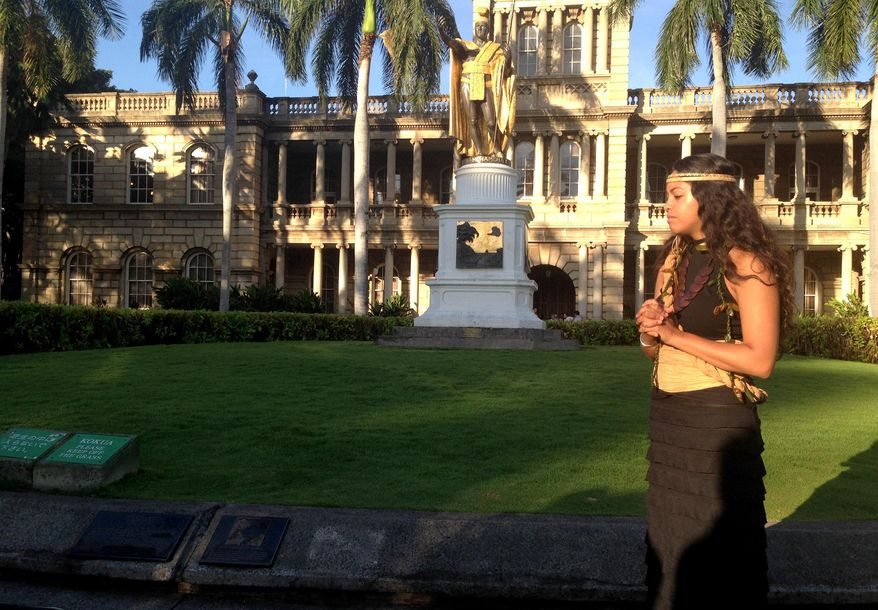 Hawane Rio stands in front of the Hawaii Supreme Court where arguments about the Thirty Meter Telescope project are happening Thursday, Aug. 27, 2015 in Honolulu. Hawaii's Supreme Court is set to hear oral arguments in a case involving building one of the world's largest telescopes on Mauna Kea, which is considered sacred land by some Native Hawiians. (AP Photo/Cathy Bussewitz)