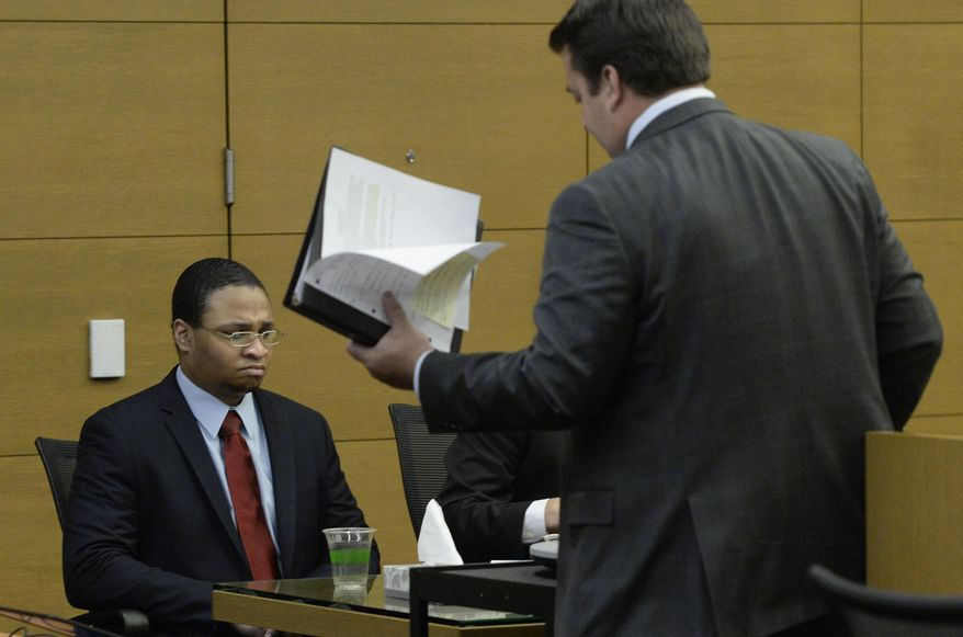 Dexter Lewis sits quietly, at left, as his  defense attorney Christopher Baumann, center,  returns to his seat following  closing arguments in the sentencing phase in Denver District Court on Thursday, Aug. 27, 2015. Jurors have spared Lewis the death penalty, and he will instead be sentenced to life in prison. Lewis was convicted Aug. 10 of five counts of murder for stabbing five people to death in a bar robbery in October 2012. (Cyrus McCrimmon/The Denver Post via AP) MAGS OUT; TV OUT; INTERNET OUT; NO SALES; NEW YORK POST OUT; NEW YORK DAILY NEWS OUT; MANDATORY CREDIT