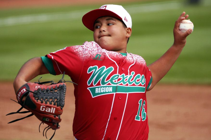 Mexico's Daniel Zaragoza delivers during the first inning of an International elimination baseball game against Venezuela at the Little League World Series tournament in South Williamsport, Pa., Thursday, Aug. 27, 2015. (AP Photo/Gene J. Puskar)