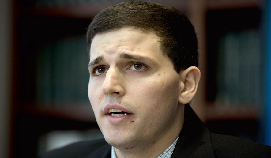 FILE - In this June 8, 2015 file photo, James Vivenzio speaks during a news conference in Philadelphia. Vivenzio, a former Penn State student from Great Falls, Va., who is suing over alleged hazing by his former fraternity, toured the fraternity house with his parents and lawyers for the involved parties seeking evidence for the case. (AP Photo/Matt Rourke, File)