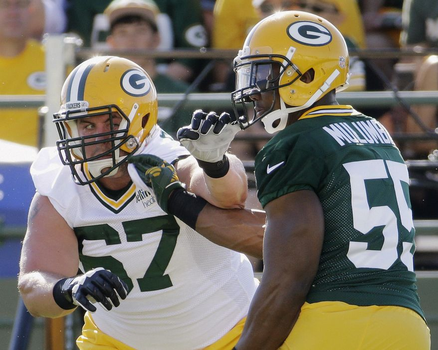 FILE - In this July 30, 2015, file photo, Green Bay Packers' Don Barclay (67) tries to block Andy Mulumba during NFL football training camp in Green Bay, Wis. Barclay has been getting first-team reps at left tackle with David Bakhtiari out. But Barclay, who might be more suited for right tackle or a guard position, struggled against the Pittsburgh Steelers last week. (AP Photo/Morry Gash, File)