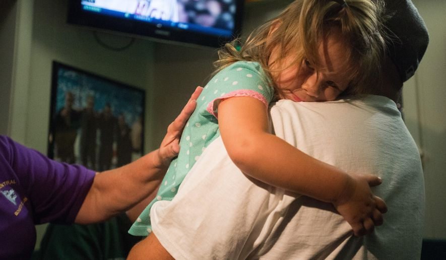 "Rick Ramirez holds his daughter Lucia, 3, as he claims the winnings of the Bay City Central Booster Club progressive ""Ace of Hearts"" raffle Wednesday, Aug. 26, at Coonan's Irish Hub, on Bay City's East Side. He wrote Lucia's on the winning ticket. (Yfat Yossifor/The Bay City Times via AP) Big Raffle"