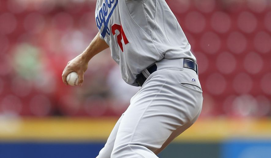 Los Angeles Dodgers starting pitcher Zack Greinke (21) throws against the Cincinnati Reds during the first inning of a baseball game, Thursday, Aug. 27, 2015, in Cincinnati. (AP Photo/Gary Landers)