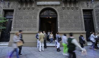 Students walk out onto the courtyard at the Del Salvador school in Buenos Aires, Argentina, Thursday, March 14, 2013. Pope Francis taught at Del Salvador in 1966, before he was ordained as a priest. (AP Photo/Alberto Murray)