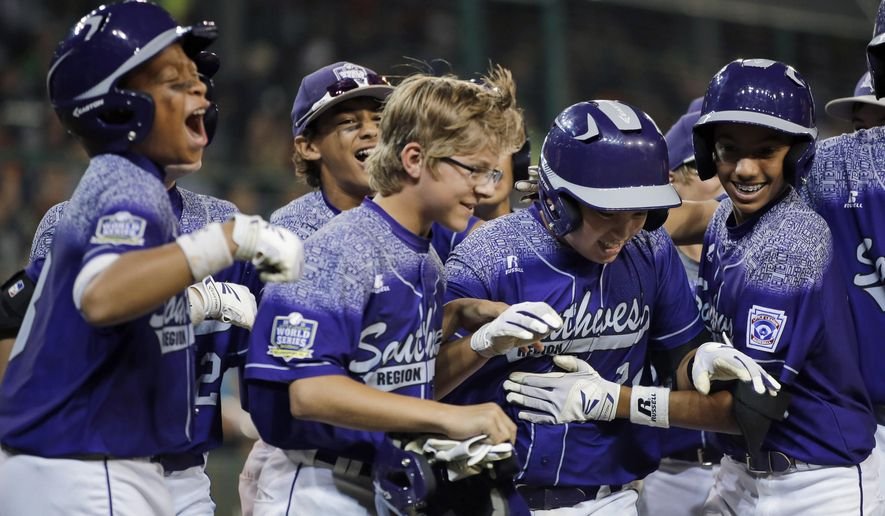 Pearland, Texas' Zack Mack, second from right, celebrates with teammates after he hit a grand slam off Bonita, Calif.'s Antonio Andrade during the first inning of a U.S. elimination baseball game at the Little League World Series, Thursday, Aug. 27, 2015, in South Williamsport, Pa. (AP Photo/Matt Slocum)