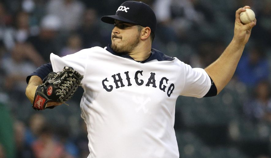 Chicago White Sox starter Carlos Rondon throws against the Seattle Mariners during the first inning of a baseball game Thursday, Aug. 27, 2015, in Chicago. (AP Photo/Nam Y. Huh)