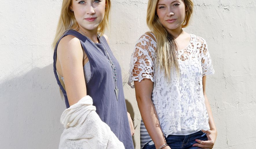"""Maddie Marlow, left, and Tae Dye, of Maddie & Tae, pose for a portrait at Love Shack Studio in Nashvile, Tenn., on Thursday, Aug. 27, 2015. Country music's young provocateurs came out swinging last summer with their on-point criticism of lyrics that portrayed women as simply objects of desire in cutoff jean shorts and bikini tops. Now that they've got everyone's attention, Marlow, 20, and Taylor """"Tae"""" Dye, 19, have got much more to say on their debut album, """"Start Here,"""" coming out on Aug. 28. (Photo by Donn Jones/Invision/AP)"""
