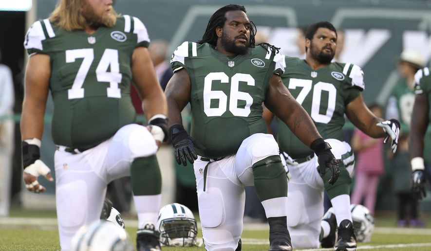 FILE - In this Friday, Aug. 21, 2015, file photo, New York Jets guard Willie Colon (66) stretches with teammates Nick Mangold (74), Dakota Dozier (70) and Jarvis Harrison (64) before an NFL preseason football game against the Atlanta Falcons in New York. Colon has dealt with knee issues during the last few years, and has a penchant for penalties. General manager Mike Maccagnan and coach Todd Bowles surprisingly brought Colon back on a one-year deal at the veteran's minimum of $870,000. Heading into the Jets' third preseason game, it appears Colon has all but wrapped up the starting job at right guard, beating out several others who were competing for the spot. (AP Photo/Adam Hunger, File)
