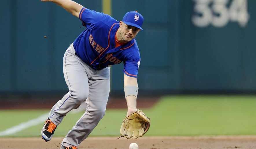 New York Mets third baseman David Wright fields a ball hit by Philadelphia Phillies' Andres Blanco and throws him out in the first inning of a baseball game, Thursday, Aug. 27, 2015, in Philadelphia. (AP Photo/Michael Perez)