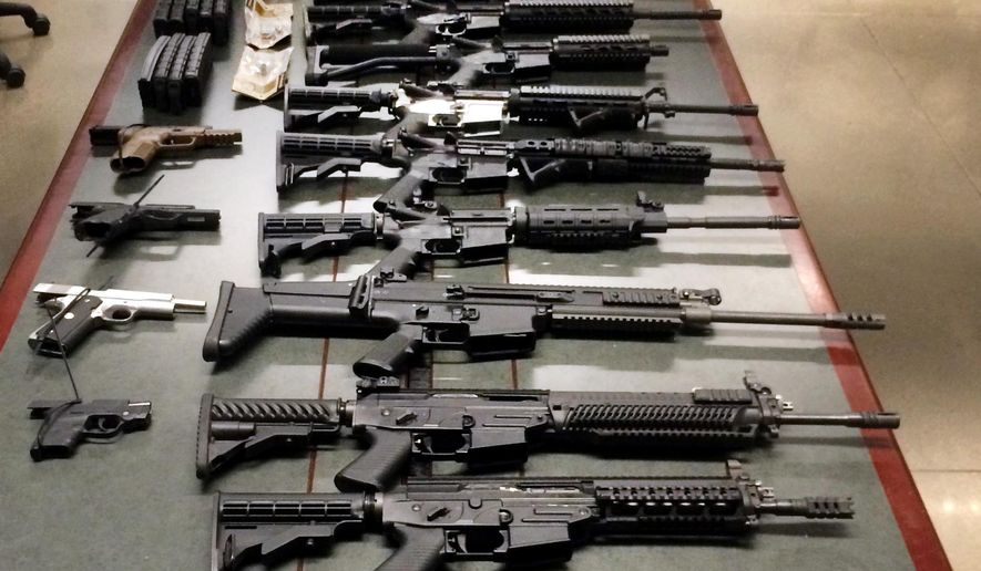 This Monday, Aug. 24, 2015 photo, shows numerous firearms after they were seized at a port in Nogales, Ariz. U.S. Customs and Border Protection says a Phoenix-area woman was attempting to smuggle the weapons, along with several ammunition magazines, into Mexico from Arizona. (U.S. Customs and Border Protection via AP)