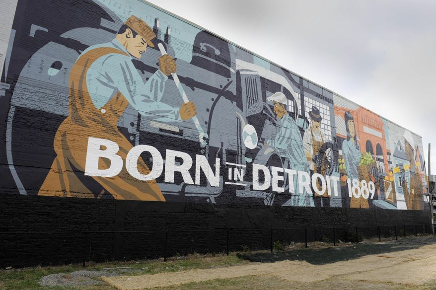 A mural decorates an outside wall of the new Carhartt store in midtown Detroit as its new store opens in Detroit's midtown, Thursday, Aug. 27, 2015. The Carhartt store is on Cass Avenue on the first floor of a building that is listed on the National Register of Historic Places. It will be the 20th company-owned retail store for Carhartt, which is based in Dearborn. (Charles V. Tines/The Detroit News via AP)