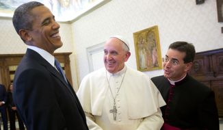 President Obama reacts as he meets with Pope Francis during their exchange of gifts at the Vatican on March 27, 2014. (Associated Press)