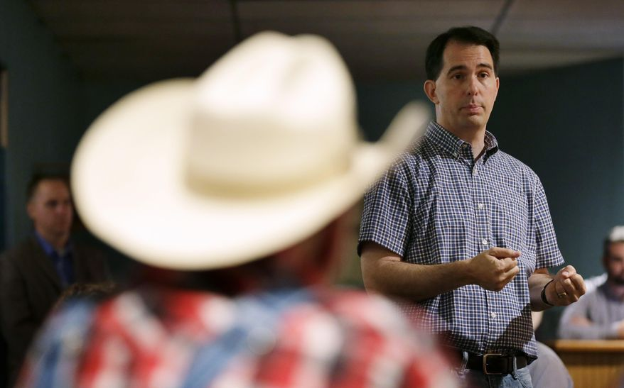 Republican presidential candidate, Wisconsin Gov. Scott Walker ,speaks during a meet and greet with local residents, Thursday, Aug. 27, 2015, in Guthrie Center, Iowa. (AP Photo/Charlie Neibergall)