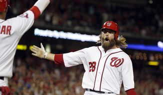 Washington Nationals' Jayson Werth celebrates scoring on a single by Bryce Harper during the seventh inning of a baseball game against the San Diego Padres at Nationals Park, Wednesday, Aug. 26, 2015, in Washington. The Padres won 6-5. (AP Photo/Alex Brandon)