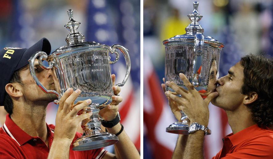 ADVANCE FOR WEEKEND EDITIONS, AUG. 29-30 - FILE -  At left, in a Sept. 12, 2011, file photo, Novak Djokovic of Serbia kisses the trophy after winning the championship match against Rafael Nadal at the U.S. Open tennis tournament in New York. At right, in a Sept. 8, 2008, file photo, Roger Federer, of Switzerland, kisses the trophy after winning the championship match against Andy Murray at the U.S. Open tennis tournament in New York. Djokovic is the No. 1 seed for the 2015 U.S. Open. Federer is seeded second. (AP Photo/File)