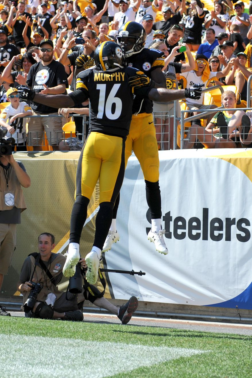 Pittsburgh Steelers wide receiver Shakim Phillips, rear, celebrates with Tyler Murphy after making a touchdown catch during the fourth quarter of the NFL preseason football game against the Green Bay Packers, Sunday, Aug. 23, 2015, in Pittsburgh. (AP Photo/Vincent Pugliese)
