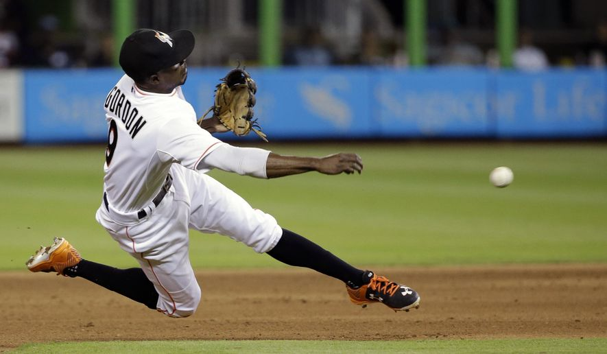 Miami Marlins second baseman Dee Gordon throws to first base to complete a double play during the eighth inning of a baseball game against the Pittsburgh Pirates, Thursday, Aug. 27, 2015, in Miami. Pirates' Sean Rodriguez was out at first and Josh Harrison was out at second. The Pirates defeated the Marlins 2-1. (AP Photo/Wilfredo Lee)