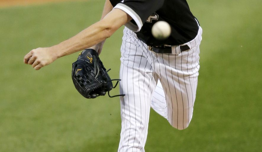 Chicago White Sox starting pitcher Chris Sale delivers during the first inning of a baseball game against the Boston Red Sox, Wednesday, Aug. 26, 2015, in Chicago. (AP Photo/Charles Rex Arbogast)