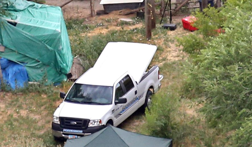FILE - This July 17, 2015, aerial photo, shows investigators looking for evidence in the field where the body of a 12-year-old girl was found, in West Valley City, Utah. A teenager charged with luring a 12-year-old neighbor from her home and killing her is set to appear in court Thursday, Aug. 27, 2015. Prosecutors say that the 15-year-old West Valley City boy strangled Kailey Vijil early the morning of July 17 , 2015, after he knocked on her door pretending to need help looking for a lost cat. (Tom Smart/The Deseret News via AP, File) SALT LAKE TRIBUNE OUT; MAGS OUT; MANDATORY CREDIT
