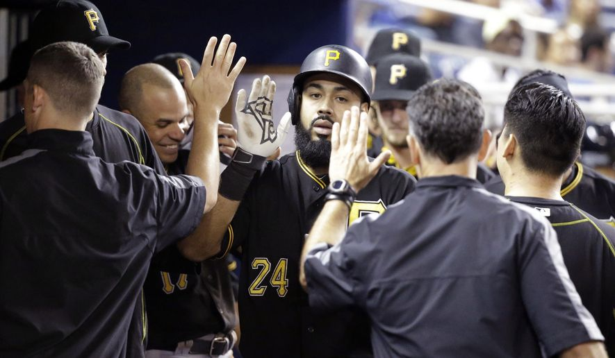 Pittsburgh Pirates' Pedro Alvarez, center, is congratulated by teammates after hitting a home run during the fourth inning of a baseball game against the Miami Marlins, Thursday, Aug. 27, 2015, in Miami. (AP Photo/Wilfredo Lee)