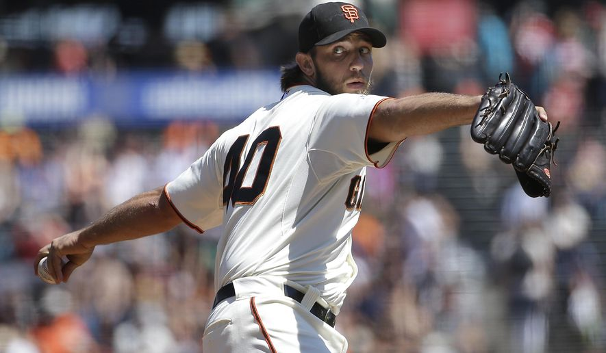 San Francisco Giants pitcher Madison Bumgarner (40) throws against the Chicago Cubs during the first inning of a baseball game in San Francisco, Thursday, Aug. 27, 2015. (AP Photo/Jeff Chiu)