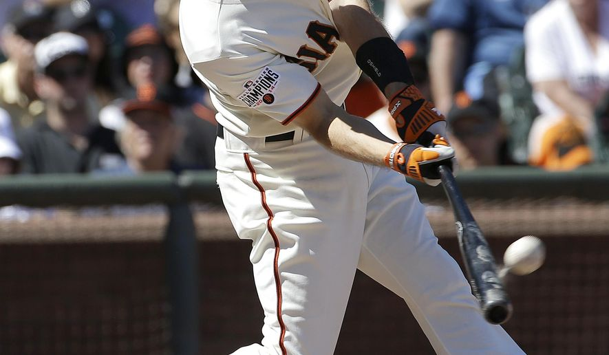 San Francisco Giants' Kelby Tomlinson hits a grand slam against the Chicago Cubs during the eighth inning of a baseball game in San Francisco, Thursday, Aug. 27, 2015. The Giants won 9-1. (AP Photo/Jeff Chiu)
