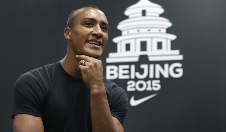 United States' Ashton Eaton speaks during an interview at the World Athletics Championships in Beijing, Tuesday, Aug. 25, 2015. Eaton, the Olympic decathlon champion and world record holder plans to wear the cooling hood to keep him cool in between events during the two-day competition when he competes at the world championships.  (AP Photo/Kin Cheung)