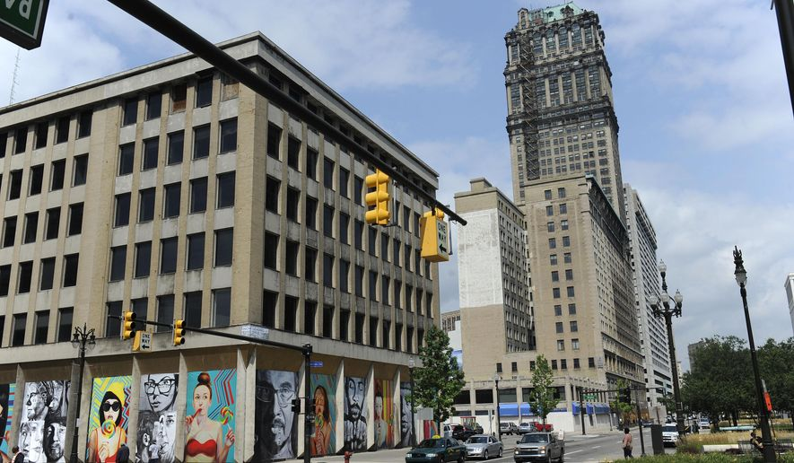 This photo shows the exterior of the 38-story Book Tower, the attached 13-story Book Building and an adjacent 2-story community center. Friday, Aug. 28, 2015 in Detroit. Dan Gilbert's ownership presence in downtown Detroit has kept growing, with the addition of a vacant 38-story office tower and adjacent buildings to his stable of properties. Book Tower, the attached 13-floor Book Building and an adjacent two-story community center have been bought by Bedrock Real Estate Services.  (David Coates/The Detroit News) DETROIT FREE PRESS OUT; HUFFINGTON POST OUT; MANDATORY CREDIT