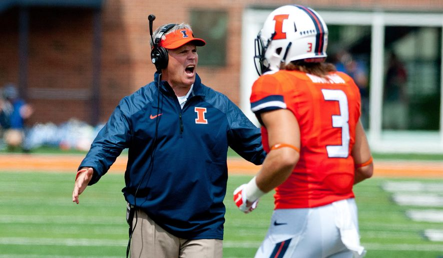 FILE - In this Sept. 6, 2014, file photo, Illinois  head coach Tim Beckman talks to defensive back Taylor Barton (3) during the third quarter of an NCAA college football game against Western Kentucky at Memorial Stadium in Champaign, Ill. Illinois fired coach Tim Beckman one week before the start of the season Friday, Aug. 29, 2015, saying preliminary results of an investigation found some truth to allegations of player mistreatment and inappropriate behavior. (AP Photo/Bradley Leeb, File)
