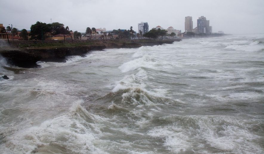 Strong winds and waves batter the coast as Tropical Storm Erika approaches Santo Domingo, in the Dominican Republic, Friday, August 28, 2015. Tropical Storm Erika began to lose steam Friday over the Dominican Republic, but it left behind a trail of destruction that included several people killed on the small eastern Caribbean island of Dominica, authorities said. (AP Photo/Tatiana Fernandez)