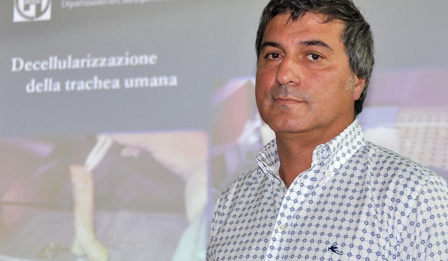 FILE - In this Friday, July 30, 2010 file photo, Dr. Paolo Macchiarini looks on during a press conference where he announced that his surgical team successfully transplanted the windpipes of two cancer patients with an innovative procedure that uses stem cells to allow a donated trachea to regenerate tissue and create an organ that is biologically close to the original, Florence, Italy. Sweden's Karolinska Institute said on Friday, Aug. 28, 2015 that Macchiarini, a leading stem cell scientist accused of unethical behavior, has been cleared of scientific misconduct though he sometimes acted without due care. (AP Photo/Lorenzo Galassi, File)
