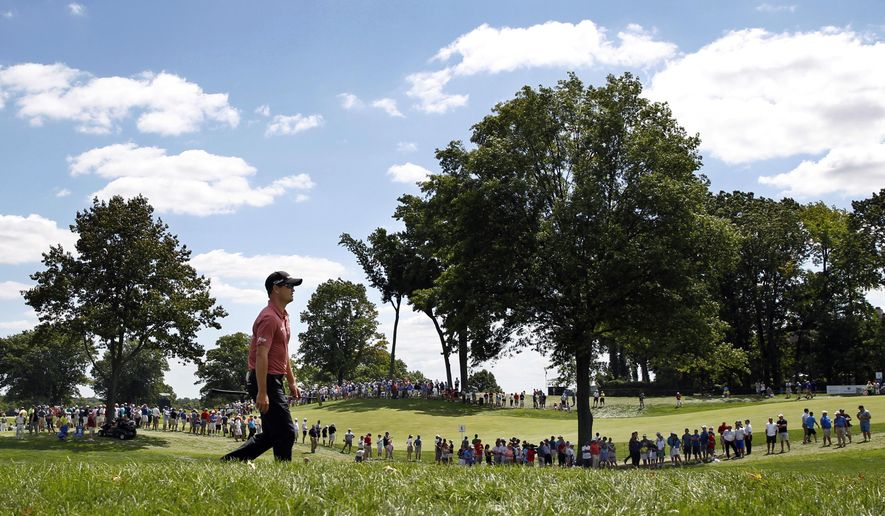 Zach Johnson walks along the fairway on the 18th hole during the second round of play at The Barclays golf tournament Friday, Aug. 28, 2015, in Edison, N.J. (AP Photo/Mel Evans)