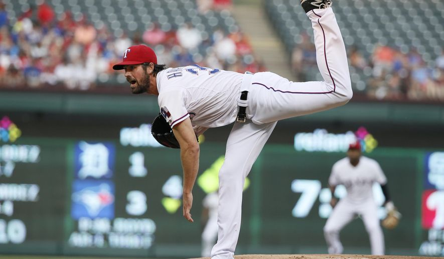 Texas Rangers starting pitcher Cole Hamels follows through on his delivery to the Baltimore Orioles in the first inning of a baseball game Friday, Aug. 28, 2015, in Arlington, Texas. (AP Photo/Tony Gutierrez)
