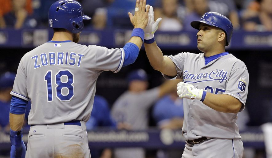 Kansas City Royals' Kendrys Morales, right, high-fives Ben Zobrist after hitting a two-run home run off Tampa Bay Rays starting pitcher Erasmo Ramirez during the third inning of a baseball game Friday, Aug. 28, 2015, in St. Petersburg, Fla. (AP Photo/Chris O'Meara)